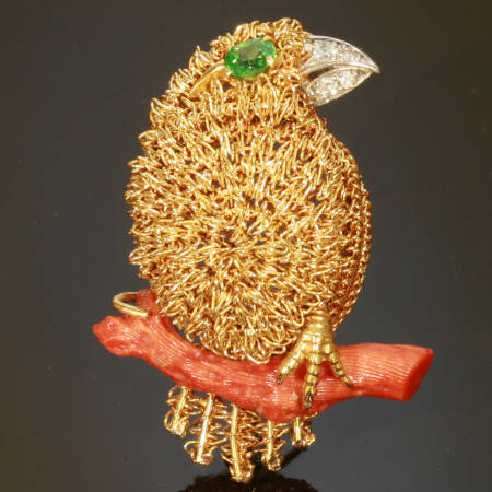 Fifties golden bird with demantoid eye and diamond beak on coral branch