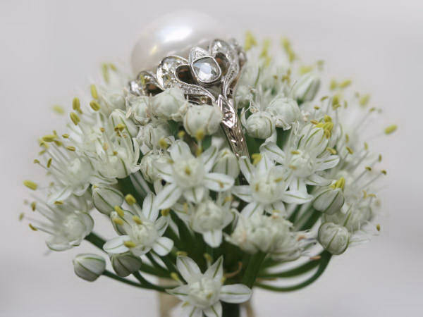White gold estate engagement ring with impressive pearl and diamonds