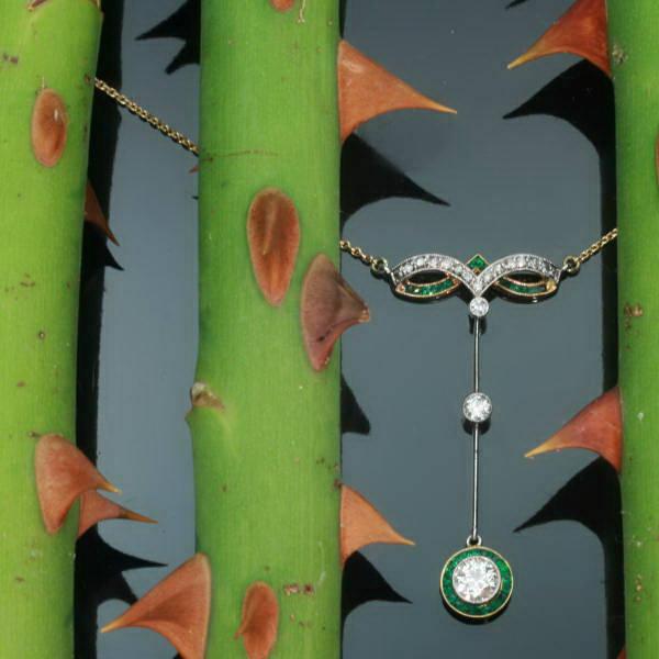 beautiful art deco diamond emerald pendant