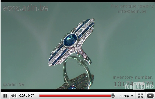 Movie of Stunning platinum Art deco engagement ring with diamonds and sapphires