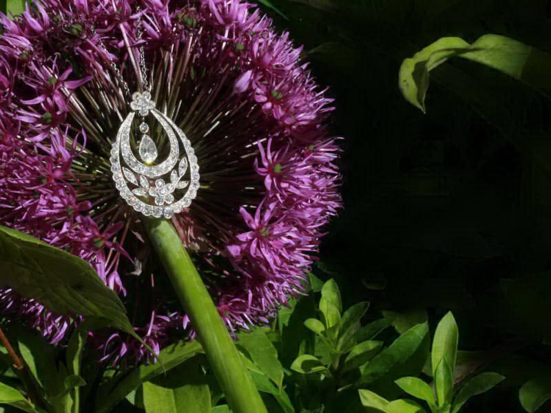 Platinum Edwardian diamond pendant in garland style with pear shape diamond