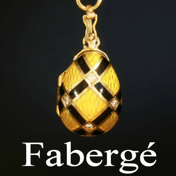 Signed and numbered Faberge gold enameled egg pendant with diamonds