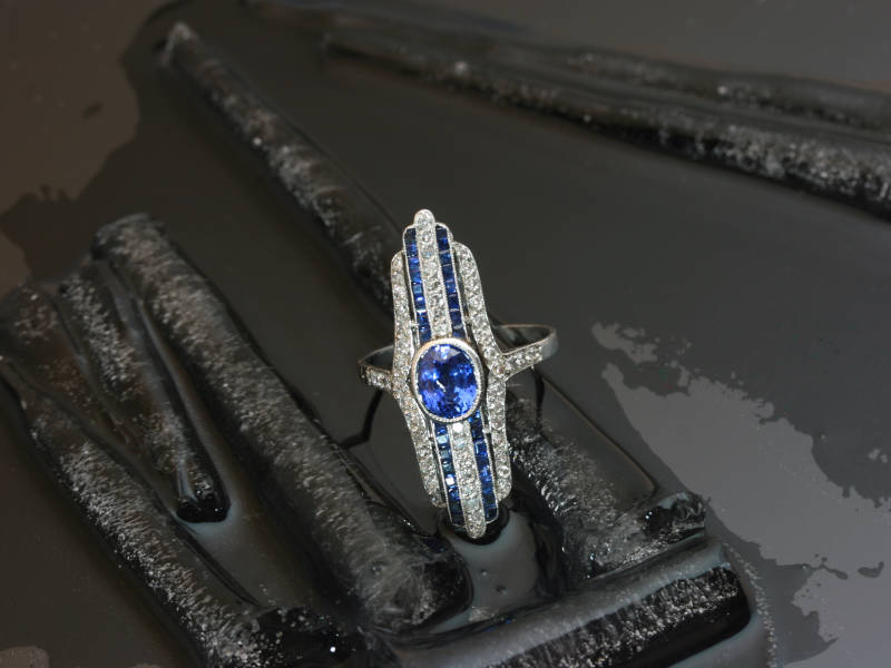 Stunning platinum Art deco engagement ring with diamonds and sapphires