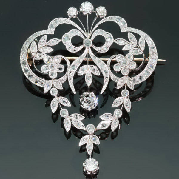 Antique Victorian brooches between $1500 and $5000