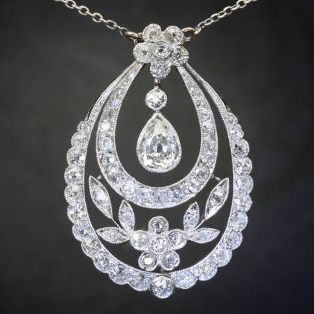 Art Deco Edwardian pear diamond solitaire pendant, flowery design from the antique jewelry collection of www.adin.be