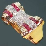 Typical bi-color gold estate Retro ring with rubies and rose cut diamonds from the antique jewelry collection of www.adin.be