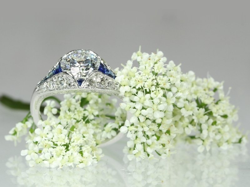Click the picture to get to see this stunning platinum Art Deco engagement ring with top brilliant and sapphires