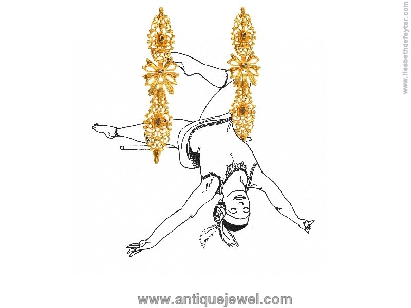Click the picture to get to see these Antique Portuguese long pendent earrings with rose cut diamonds high carat gold.