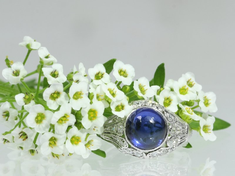 Click the picture to get to see this charming vintage engagement ring with diamonds and sapphire