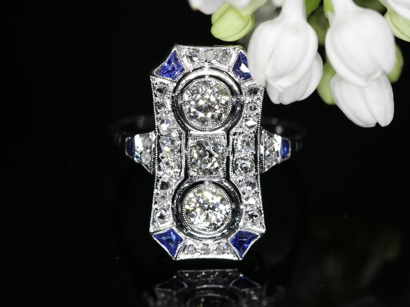 Click the picture to get to see this Typical Art Deco platinum diamond engagement ring.