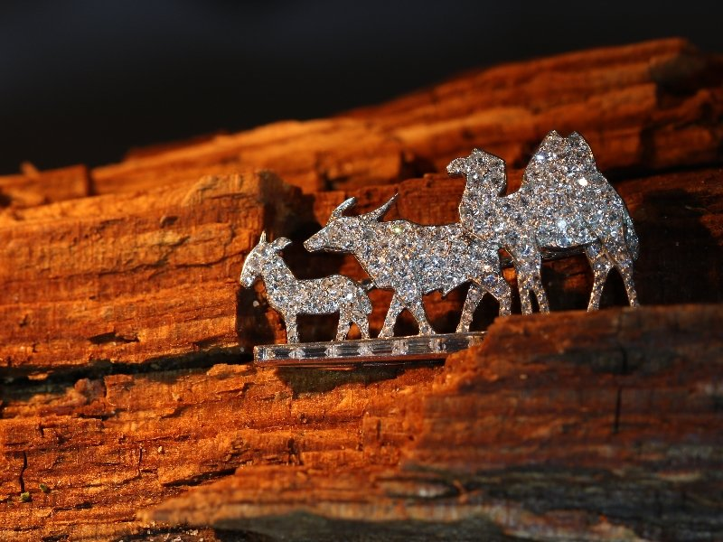 Click the picture to get to see this Fairylike Cartier Paris Art Deco diamond brooch with donkey/mule, buffalo and camel.