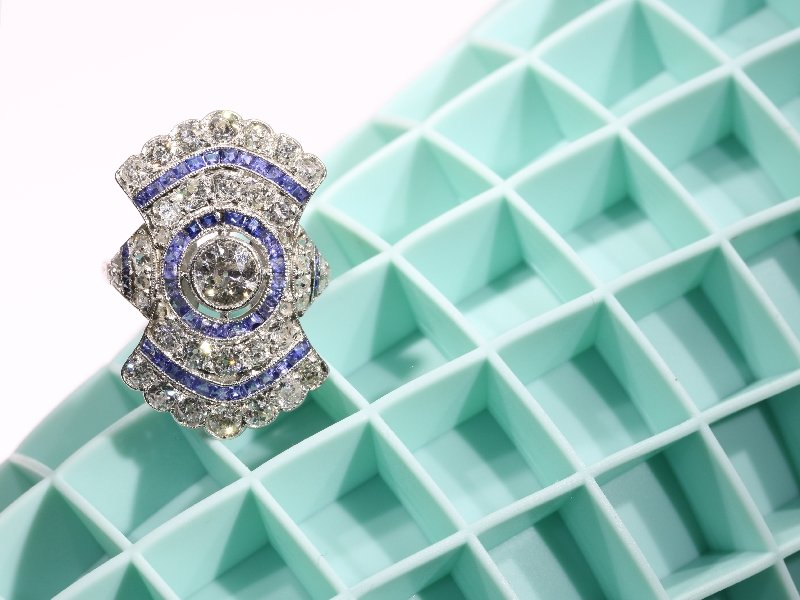 Click the picture to get to see this Radiating diamond and sapphire Art Deco ring.