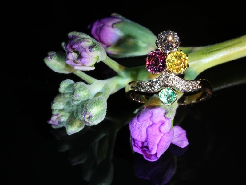 Click the picture to get to see this Antique ring typical so-called Suffragette diamond ring with precious stones.