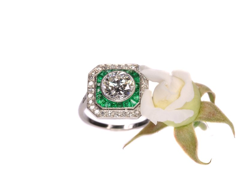 Click the picture to get to see this Art Deco platinum engagement ring with 1.55 ct white diamond and Brazilian emeralds.