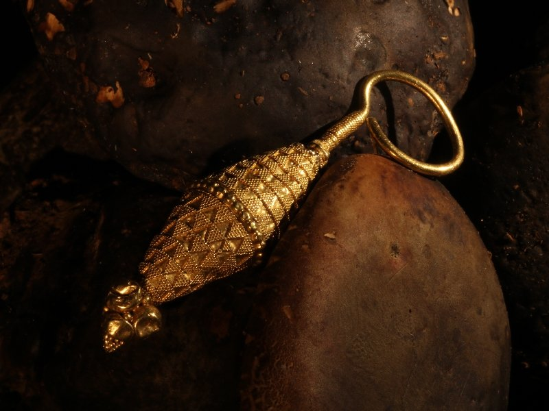 Click the picture to get to see this Ancient yellow gold granulated ear-ring.