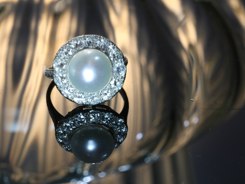 Click the picture to get to see this diamond and pearl platinum estate engagement ring.