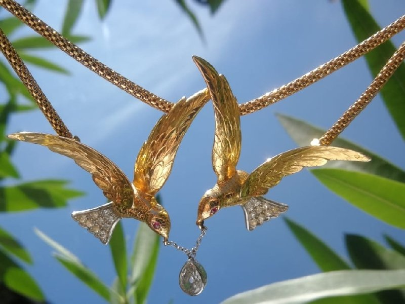 Click the picture to get to see this French Fifties necklace with two flying swallows carrying a pear shaped diamond.