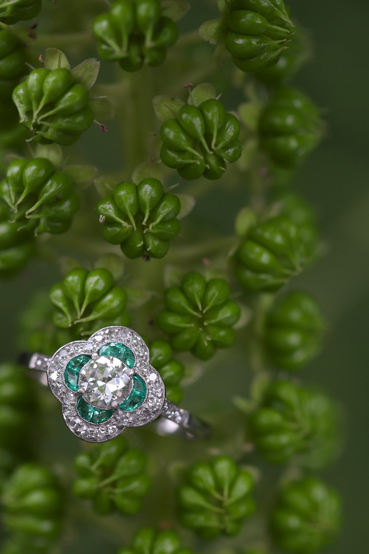 Click the picture to get to see this Art Deco diamond and emerald engagement ring.