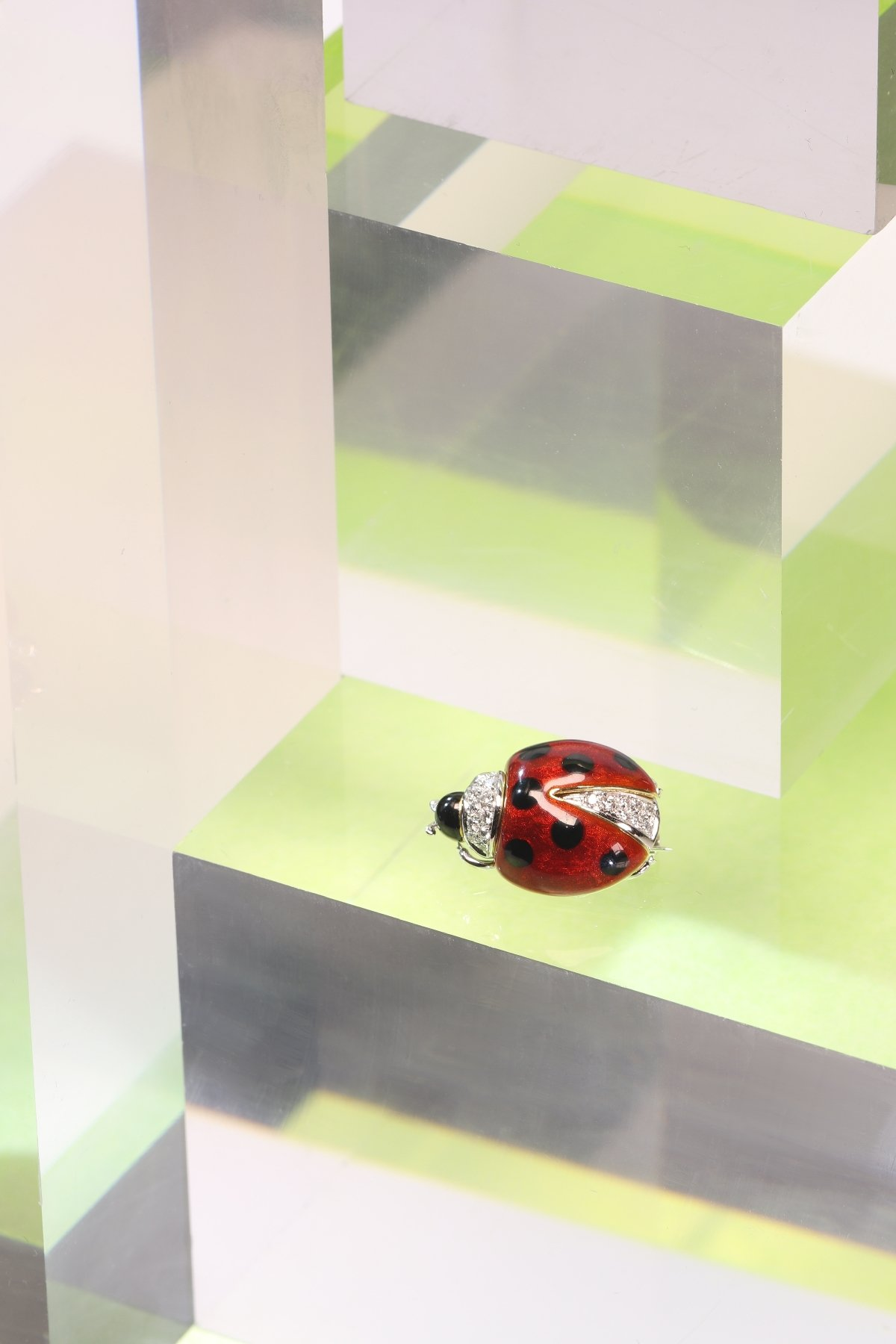 Click the picture to get to see this Vintage enameled gold ladybug brooch with diamonds.