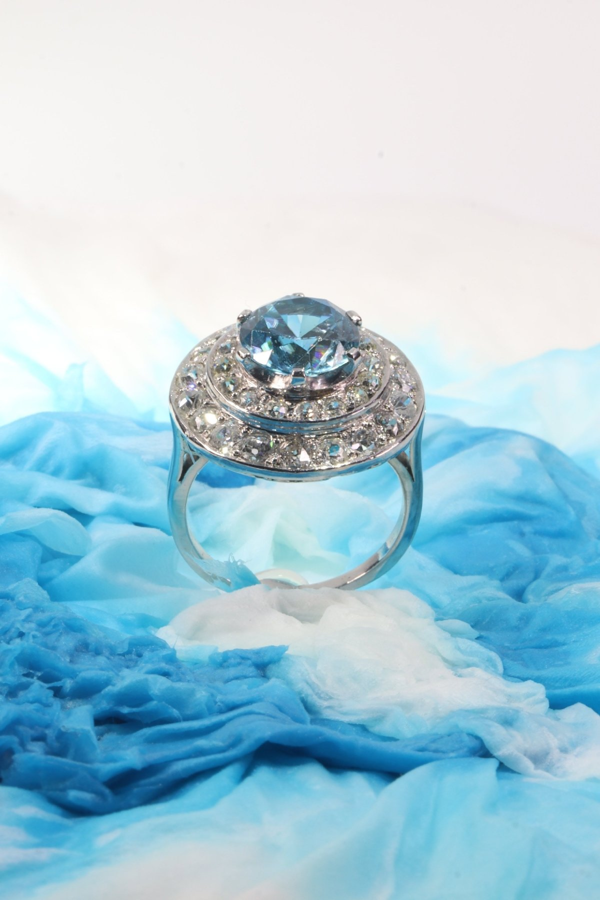 Click the picture to get to see this Vintage Fifties ring diamond loaded with a big starlite.
