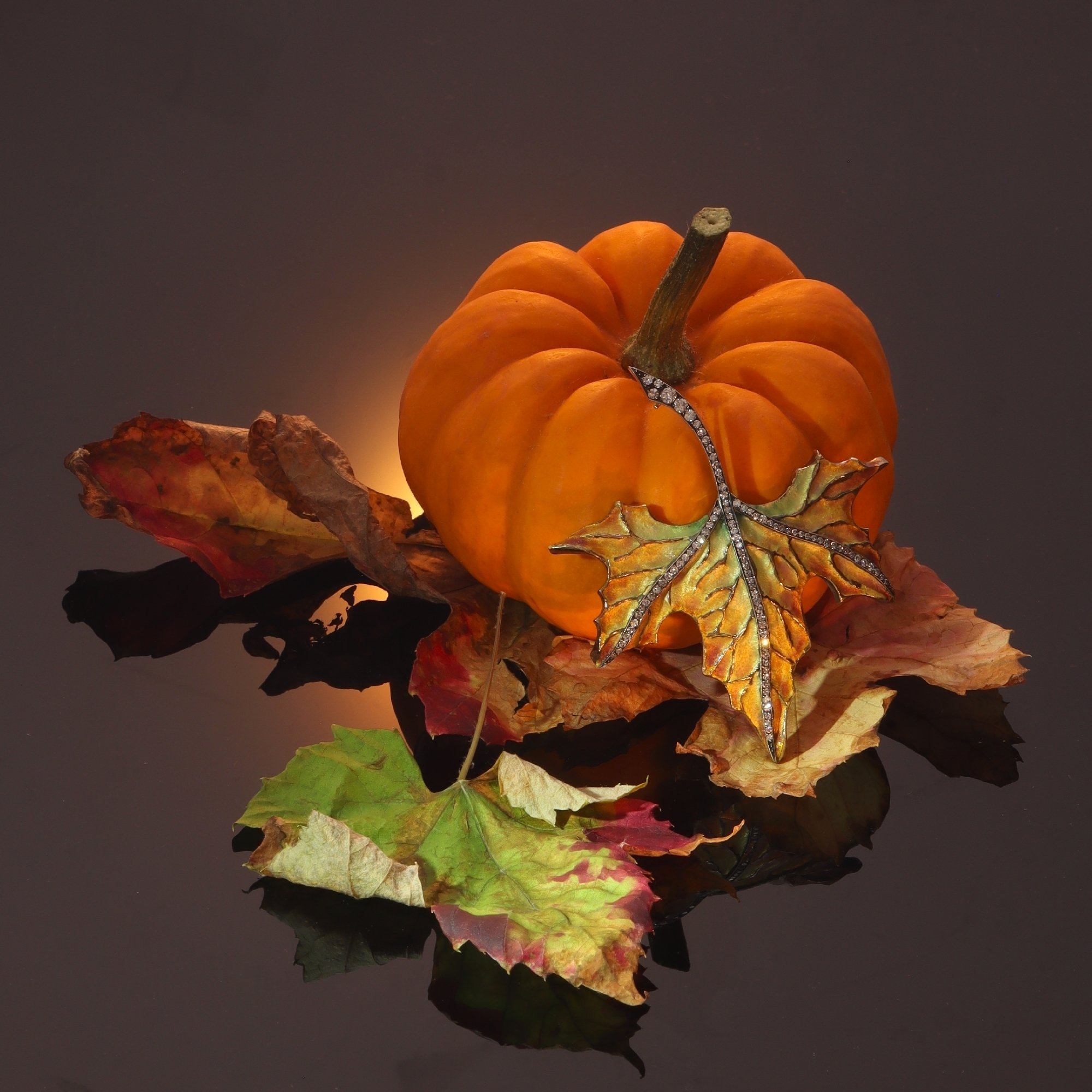 Click the picture to find out more about this vintage gold and diamond autumn leaf brooch